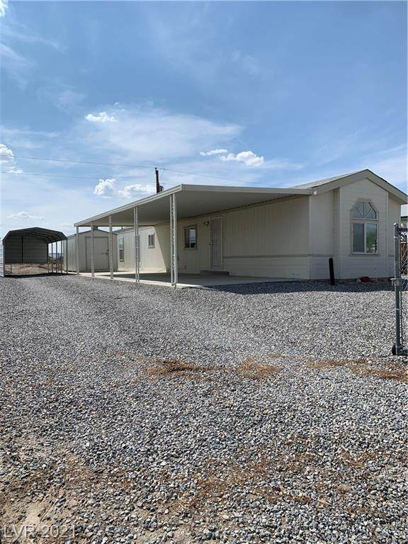 1460 S Comstock Circle, Pahrump, NV 89048 (MLS #2319089) :: Lindstrom Radcliffe Group