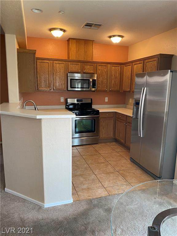 4615 Puglia Lane #202, North Las Vegas, NV 89084 (MLS #2297071) :: Vestuto Realty Group