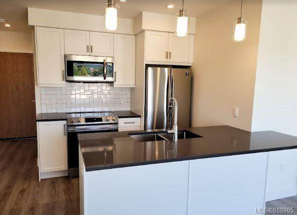 119 Haliburton St #207, Nanaimo, BC V9R 4V9 (MLS #888805) :: Call Victoria Home