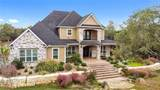 1150 Whispering Oaks - Photo 1
