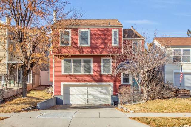 4438 Dunraven Dr, West Valley City, UT 84119 (#1720171) :: goBE Realty