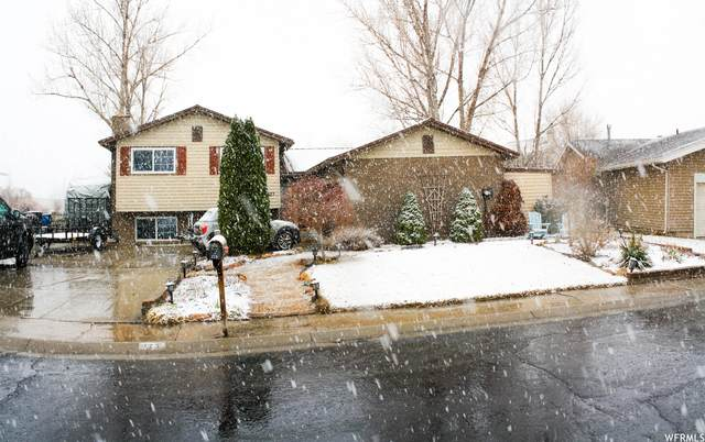 123 Country Clb, Stansbury Park, UT 84074 (#1729460) :: goBE Realty