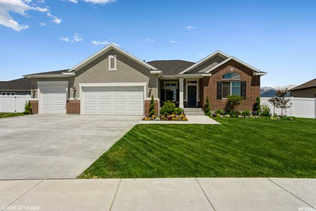 304 N Blue Spruce Dr, Layton, UT 84041 (#1744285) :: Doxey Real Estate Group