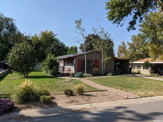 6870 S Village Green Rd E, Salt Lake City, UT 84121 (#1771668) :: Doxey Real Estate Group