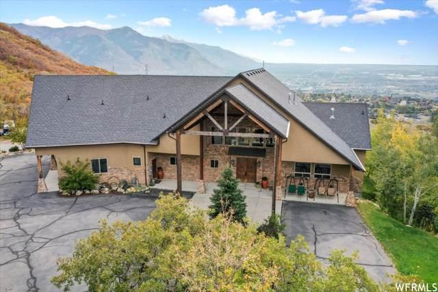 5056 N Ridge Canyon Rd W, Pleasant View, UT 84414 (#1774421) :: Real Broker LLC