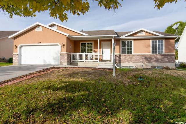 3268 S Hunter View Dr W, West Valley City, UT 84128 (#1775982) :: Colemere Realty Associates