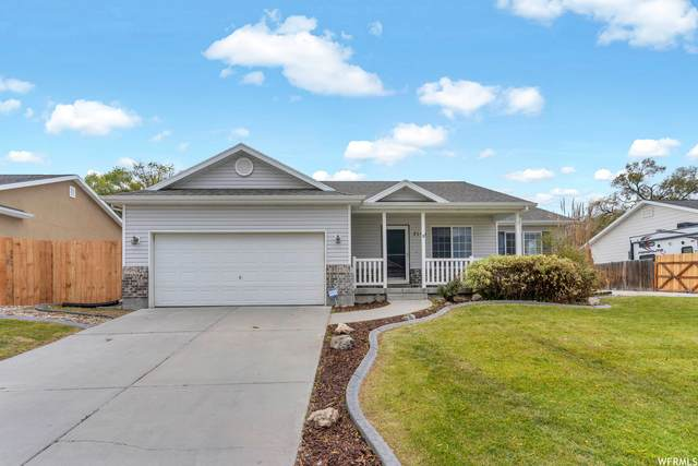 7145 W Hawker Ln, West Valley City, UT 84128 (#1776835) :: UVO Group