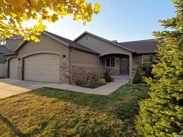7058 W Saw Timber Way, West Jordan, UT 84084 (#1487546) :: Colemere Realty Associates