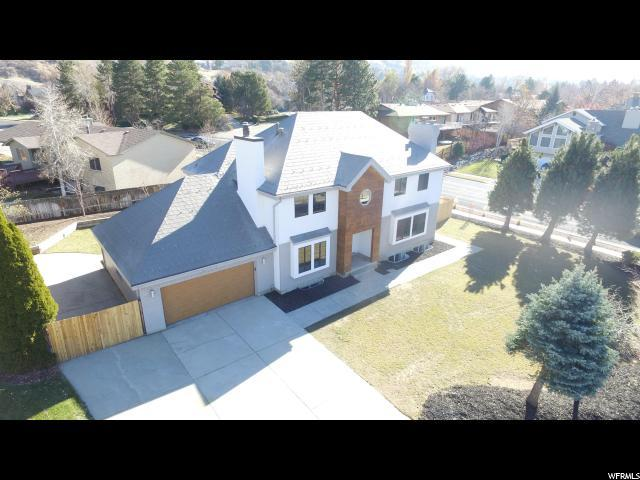 8065 S Overhill Cir, Cottonwood Heights, UT 84121 (#1495377) :: Colemere Realty Associates