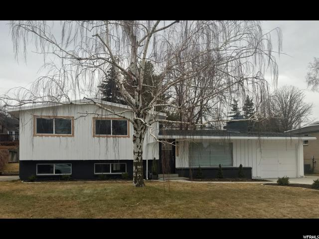 2112 E Villaire Ave, Cottonwood Heights, UT 84121 (#1500923) :: goBE Realty