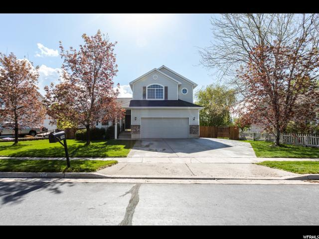 704 Country Club Dr, Stansbury Park, UT 84074 (#1522396) :: goBE Realty