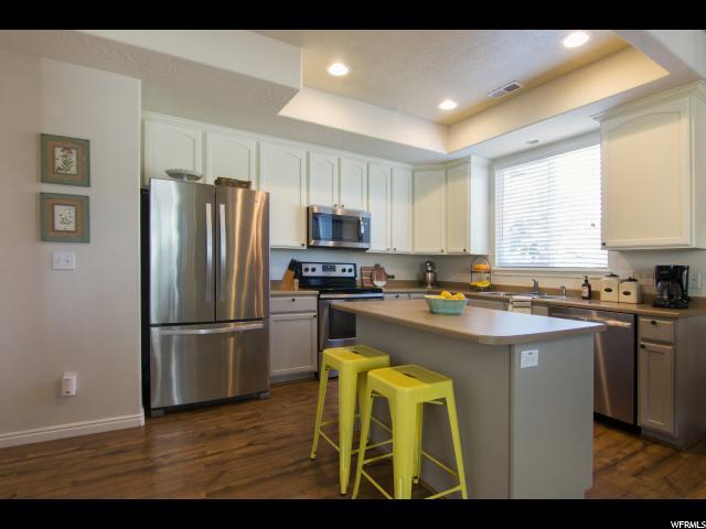 6928 W Bamburgh Way S, West Valley City, UT 84128 (#1536683) :: Eccles Group