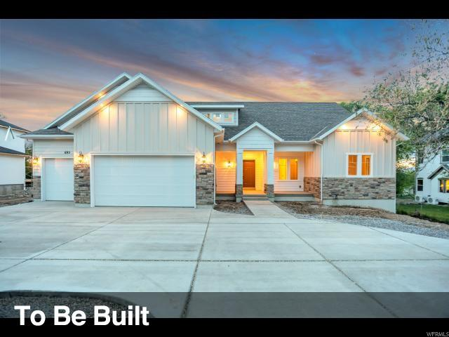 7719 N Cobblerock Rd, Lake Point, UT 84074 (#1545977) :: Exit Realty Success