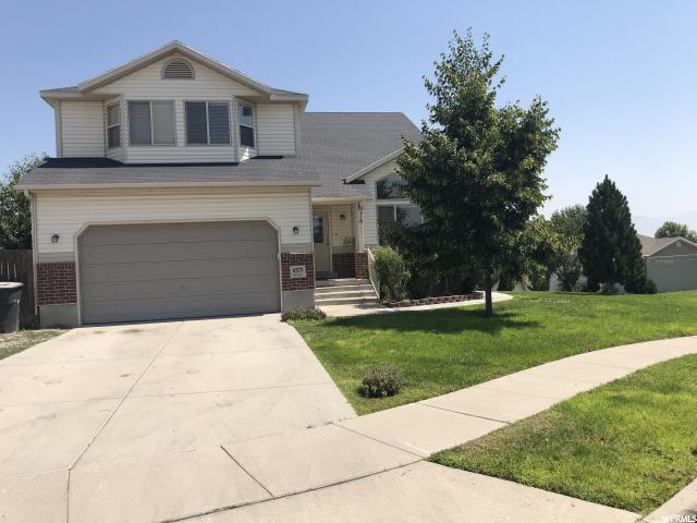 6575 S Cedar Creek Cir W, West Valley City, UT 84118 (#1546727) :: goBE Realty
