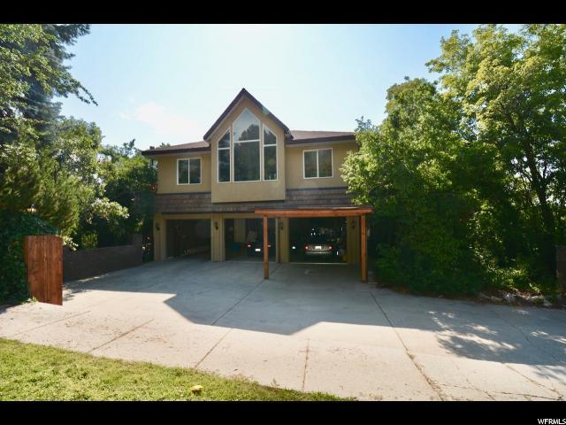 8762 S Kings Hill Dr, Cottonwood Heights, UT 84121 (#1548833) :: goBE Realty