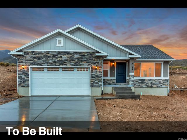 7827 N Cobblerock Rd, Lake Point, UT 84074 (#1548928) :: The Fields Team