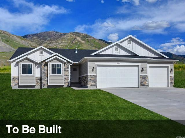 7833 N Cobblerock Rd, Lake Point, UT 84074 (#1548941) :: The Fields Team