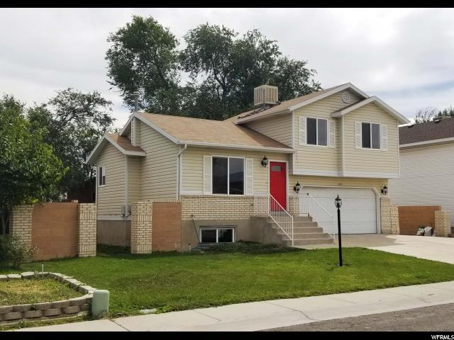 3327 S Rose Hollow Ln W, West Valley City, UT 84119 (#1551701) :: goBE Realty