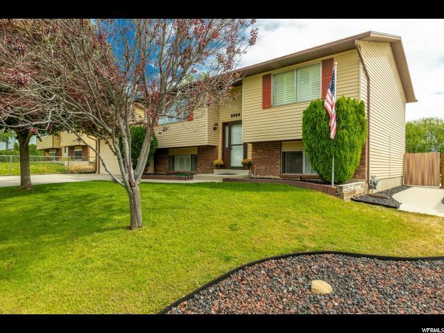 5989 S Country Hills Dr W, Taylorsville, UT 84129 (#1552032) :: Exit Realty Success