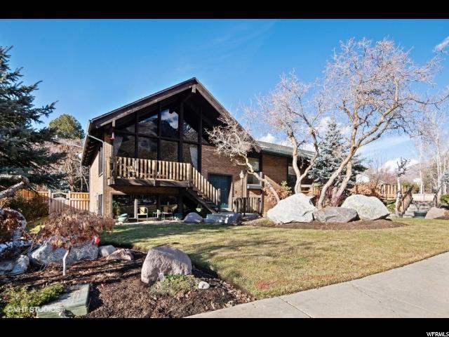8830 S Grand Oak Dr, Cottonwood Heights, UT 84121 (#1572459) :: goBE Realty