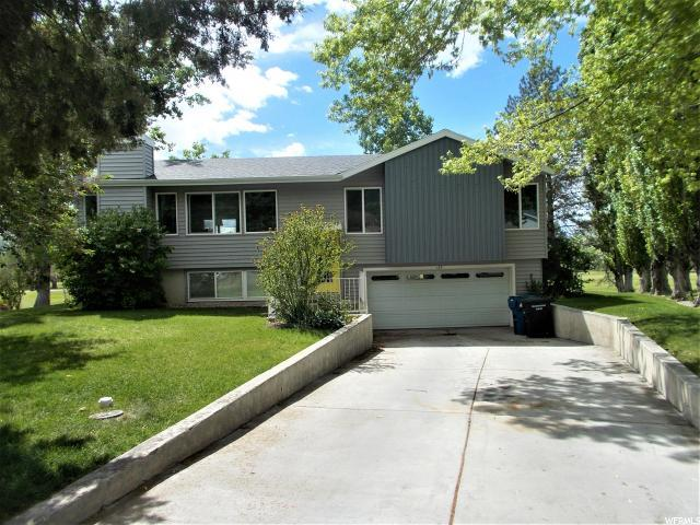 185 Country Club Dr, Stansbury Park, UT 84074 (#1602341) :: Action Team Realty