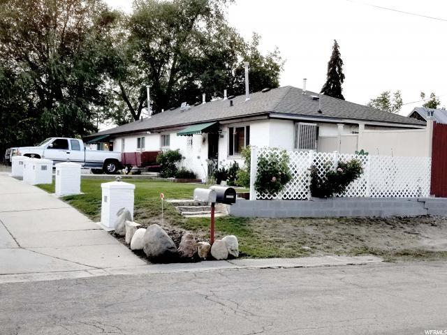 7004 Brookhill Dr, Salt Lake City, UT 84121 (#1615566) :: goBE Realty