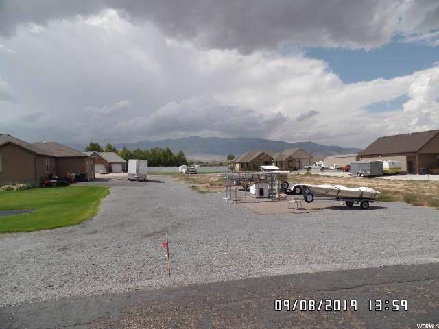 557 S 557 CHRISTLEY LN. E, Grantsville, UT 84029 (#1630324) :: Colemere Realty Associates