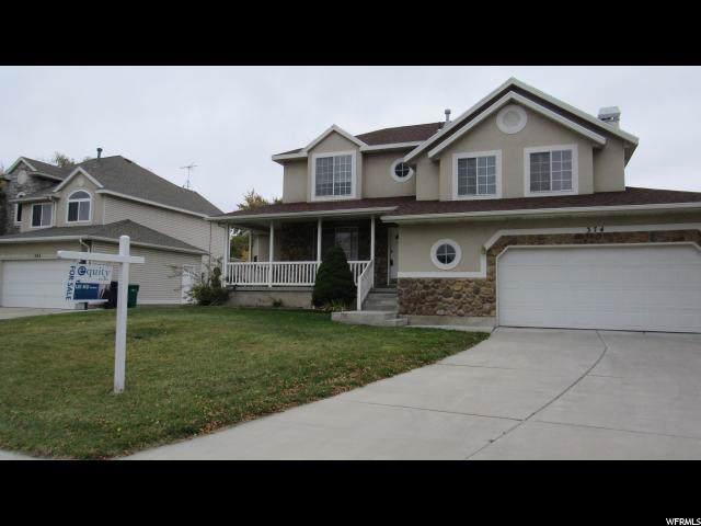 7620 S Sandy Park Cir E, Midvale, UT 84047 (MLS #1631100) :: Lookout Real Estate Group