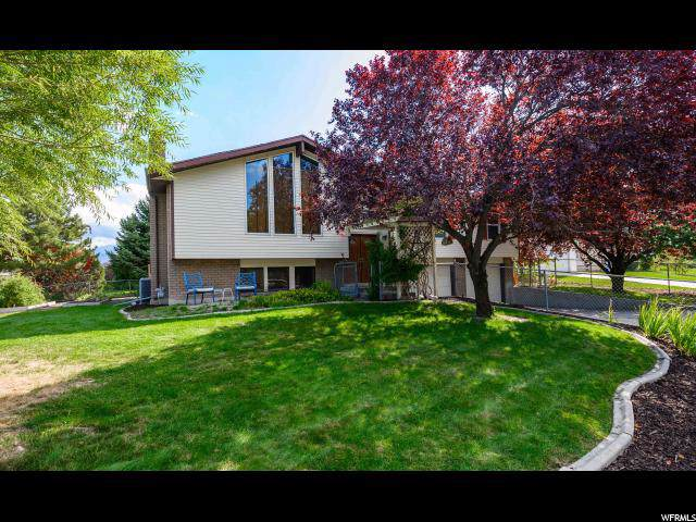 5527 S Hollow Springs Dr W, Murray, UT 84123 (#1634809) :: Colemere Realty Associates