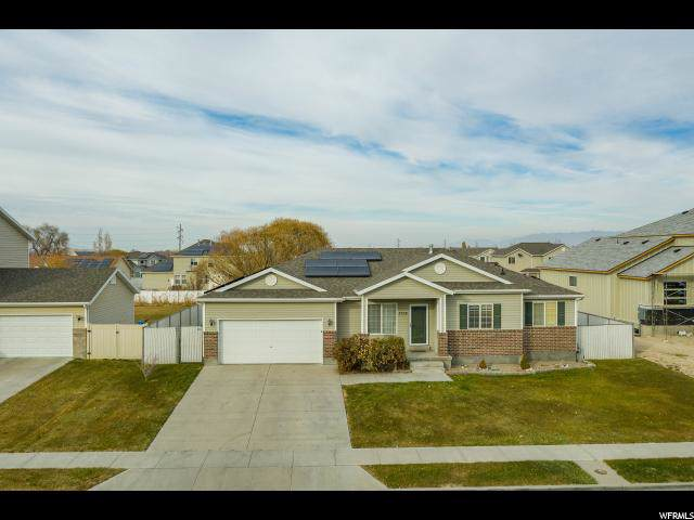 7038 W 3100 S, West Valley City, UT 84128 (#1643275) :: Colemere Realty Associates