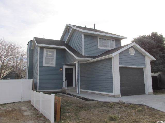 8479 S 3155 W, West Jordan, UT 84088 (#1643433) :: goBE Realty