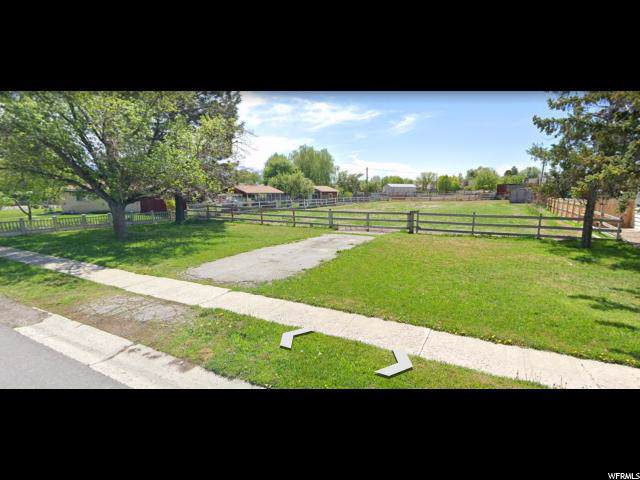 2435 W Surrey Rd S, Taylorsville, UT 84129 (#1652394) :: Action Team Realty