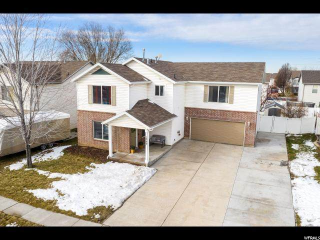 1960 S 725 E, Clearfield, UT 84015 (#1654774) :: The Canovo Group