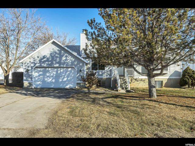 2424 W 1800 N, Clearfield, UT 84015 (#1656412) :: The Canovo Group