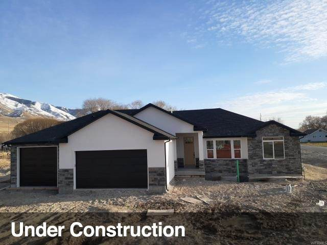 1776 E Davies Place Rd, Lake Point, UT 84074 (#1657326) :: Colemere Realty Associates
