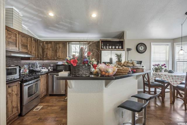 3492 S Eastcrest Rd W #202, West Valley City, UT 84120 (#1660960) :: Doxey Real Estate Group