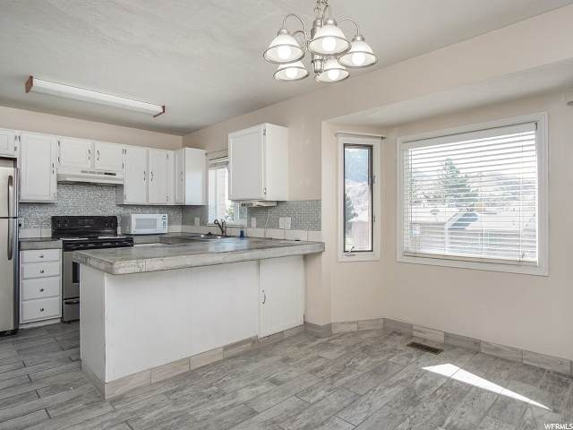 1679 E 1450 S, Ogden, UT 84404 (#1666443) :: Gurr Real Estate Team
