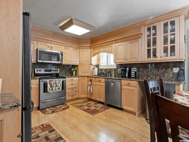 5014 W 6515 S, West Jordan, UT 84081 (#1674909) :: EXIT Realty Plus