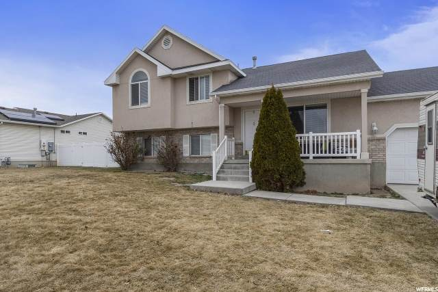 3216 S Sugar Bowl Ln W, West Valley City, UT 84128 (#1676809) :: Colemere Realty Associates