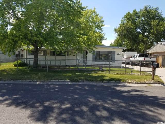 3238 S Cantwell St W, West Valley City, UT 84119 (#1677803) :: goBE Realty