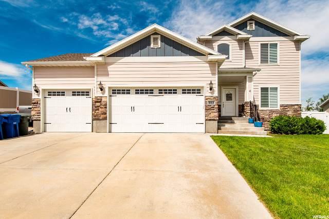 4414 S Wynridge Ln W, West Valley City, UT 84128 (#1678415) :: Exit Realty Success
