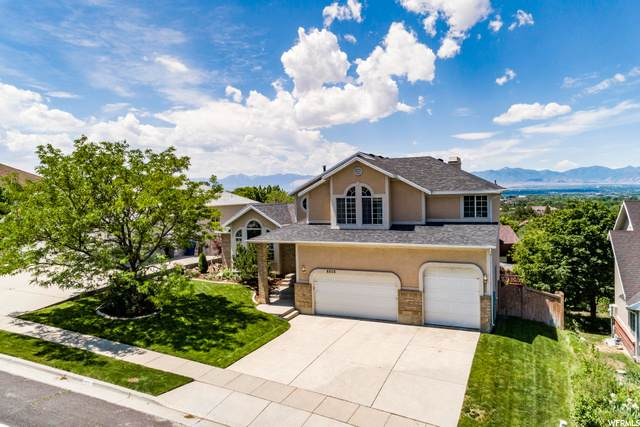 6908 S Hollow Mill Dr, Salt Lake City, UT 84121 (#1679090) :: goBE Realty