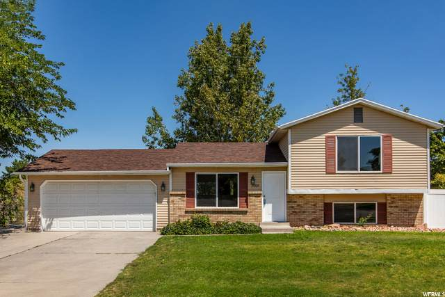 7028 W Kings Estate Dr, West Valley City, UT 84128 (#1691030) :: Exit Realty Success