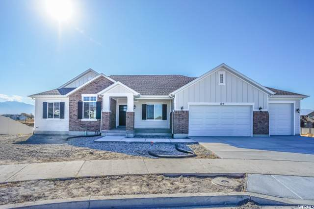 129 W Magnolia Cir, Stansbury Park, UT 84074 (#1698056) :: Red Sign Team