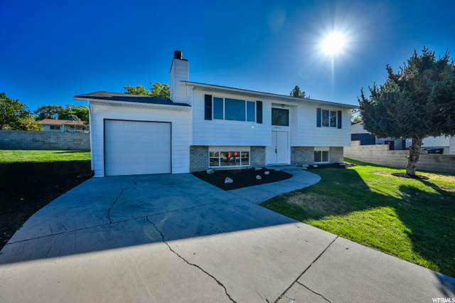 7051 W Cimmarron Dr, West Valley City, UT 84128 (#1704596) :: The Perry Group