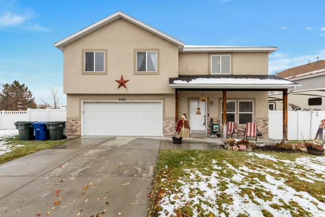 3162 S Village Pine Cv W, West Valley City, UT 84119 (#1712562) :: Red Sign Team