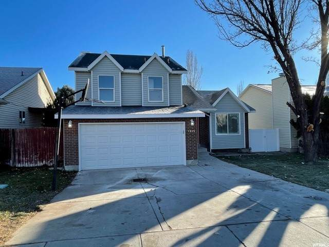 7829 S Palladium Dr, West Jordan, UT 84088 (#1714666) :: Colemere Realty Associates