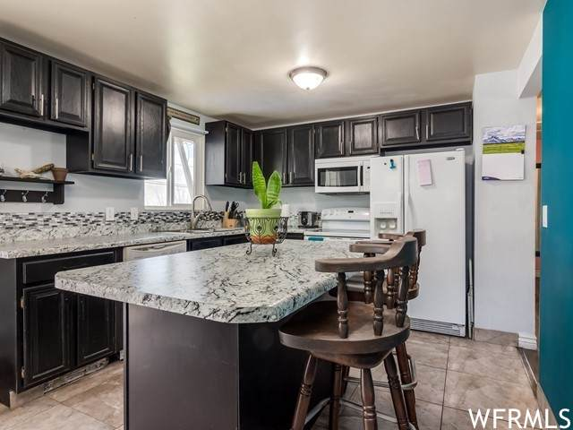 4412 W Lander Way S, Salt Lake City, UT 84118 (#1732017) :: The Fields Team
