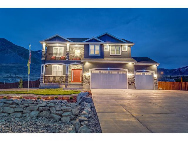 7816 Buckhorn Rd, Lake Point, UT 84074 (#1517162) :: goBE Realty