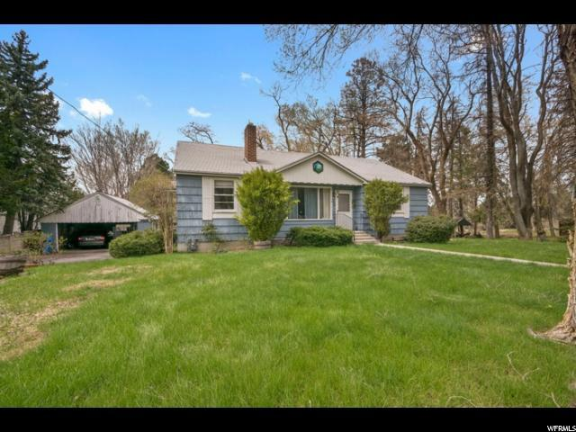 8296 S Wasatch Blvd E, Cottonwood Heights, UT 84121 (#1518188) :: goBE Realty